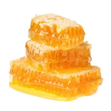 kam: Honing raat geïsoleerd op witte achtergrond  Stockfoto