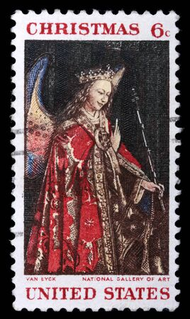 collectible: A stamp printed in the USA shows picture by artist Jan van Eyck, circa 1920s. Isolated on black Stock Photo