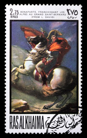 napoleon: A stamp printed in Ras-Al-Khaima (UAE) shows Napoleon (painting by L. David), circa 1969. Isolated on black Stock Photo