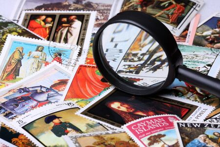 Stamp collection with magnifying glass, shallow depth of field photo