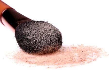 Make-up powder and brush isolated on white background