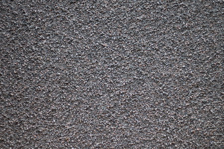 gritty: ground gravel texture in parking lot