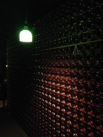 wine cellar champagne bottles sparking wine cave stacked