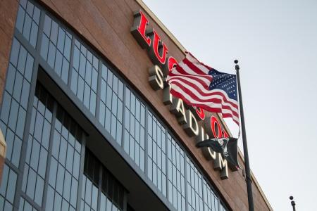 lucas: American Flag waving in front of Lucas Oil Stadium