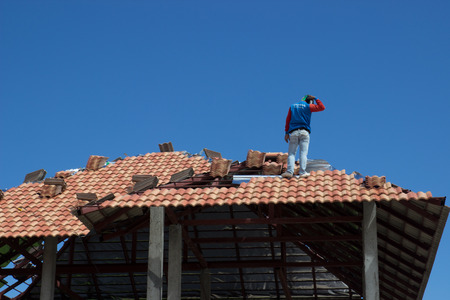 rafter: man work on home roof construction