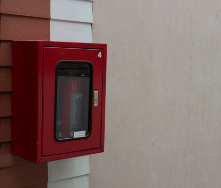 foam safe: fire extinguisher on red white wall
