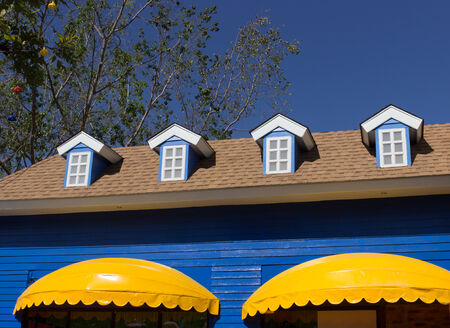 awnings: yellow awning and blue window shop