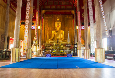 golden buddha statue in church