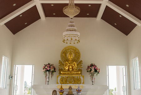 golden buddha statue in white church