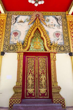 the art sculpture of Thailand temple door photo
