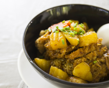 japanese fried pork with potato on curry rice photo