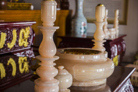 of homage: marble candlestick and joss stick pot for paying homage Editorial