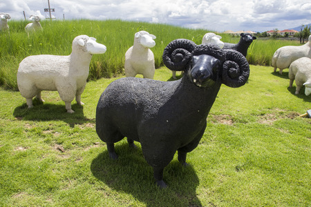 adornment: black and white sheep statue for adornment