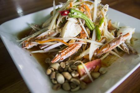 asian spicy papaya salad with blue crab photo