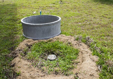 Precast concrete of lavatory buried in lawn yard and on the ground Stock Photo