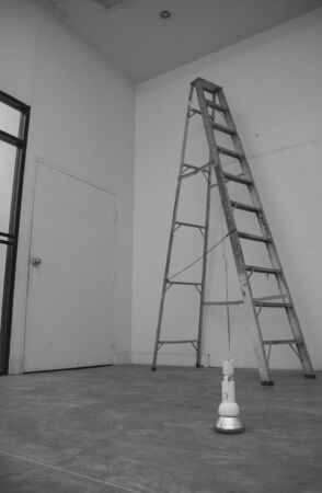 light bulb on the floor in front of the ladder photo