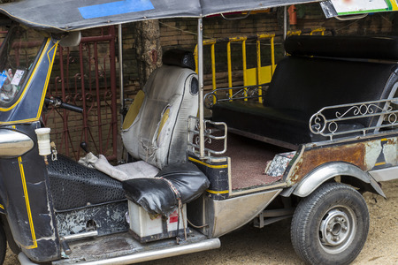 old tuktuk tricycle for tourist in Thailand photo