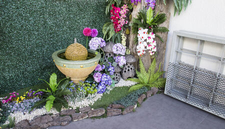 Colorful Fake Flower Decorating With Fountain In Small Garden ...