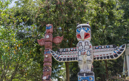 aboriginal bird sculpture statue in a park photo