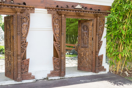 the cambodian carving design on wooden door Stock Photo