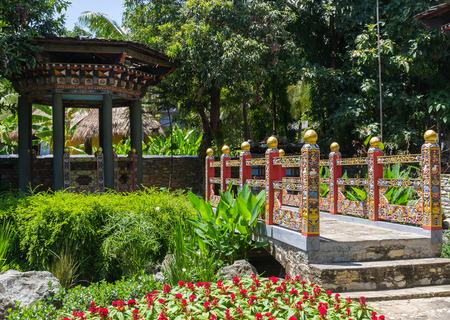 Stock Photo   The Design Of Bhutan Bridge And Pavilion In The Garden