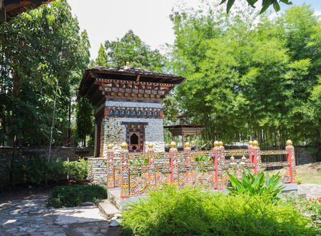 Stock Photo   The Design Of Bhutan Bridge And Building In The Garden