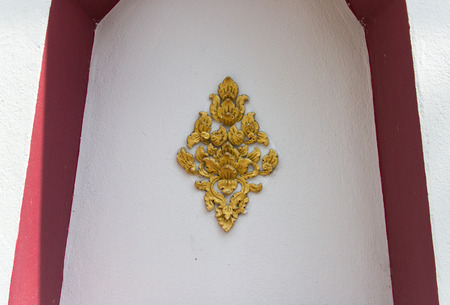 asian art: the art of handmade asian golden sculpture tracery for decorating on the white wall Editorial