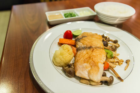 grilled sea bass with fried Cauliflowers,mushroom and carrot photo