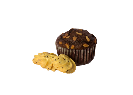 chocolate cupcake with cashew nut isolated on white background photo