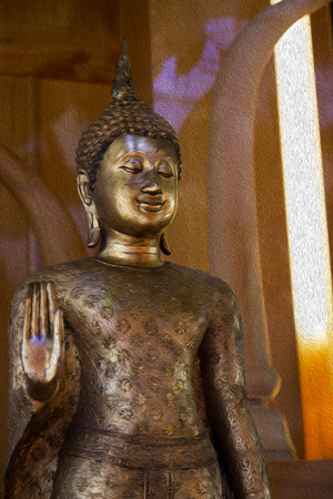 forbidding: oil paint effect on the image of ancient golden standing buddha statue with the forbidding hand acting Stock Photo