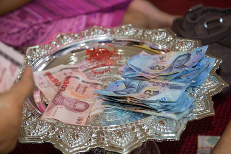 fifty and hundred baht thailand banknote that people donate to the temple photo