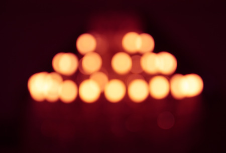 highlight lighting. Stock Photo - The Blurry Defocused Image Of Yellow Lighting From Chandelier  With Highlight And Red Shadow .
