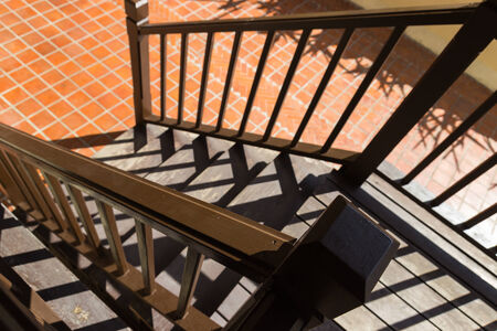 bannister: shadow of the bannister on wooden stair step Stock Photo