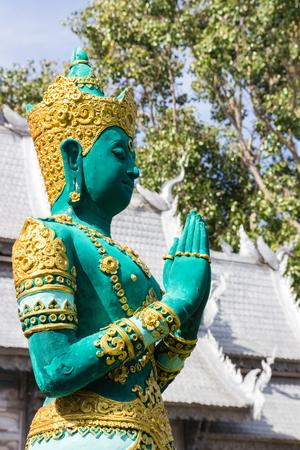 asian angel: the design of green asian angel sculpture wearing golden jewelry