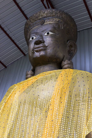 monk robe: big buddha statue with yellow monk robe