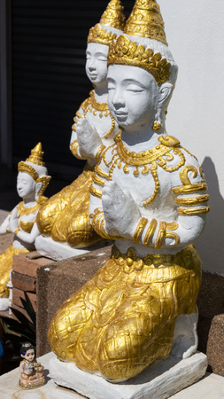 asian angel: the design of asian angel sculpture wearing golden jewelry