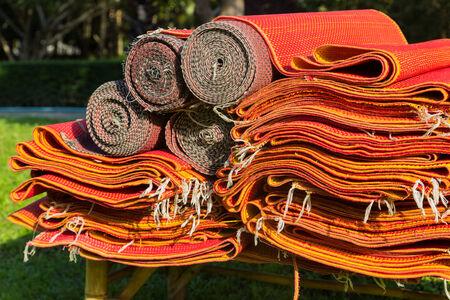 rattan mat: pile of red asian rattan mat in the garden