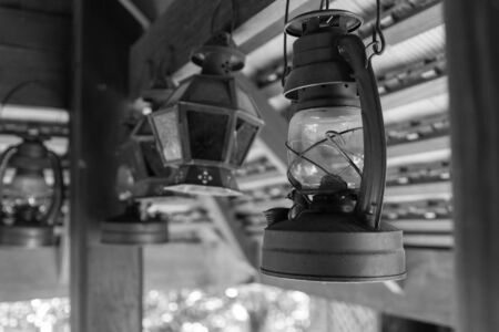 counterbalance: antique storm lantern hanging from the counterbalance Stock Photo