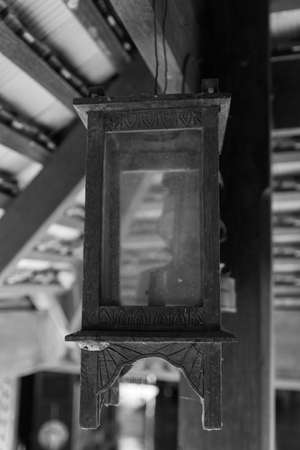 counterbalance: antique wooden lantern hanging from the counterbalance Stock Photo
