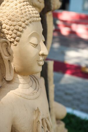 smiling buddha: right side of smiling beige buddha statue