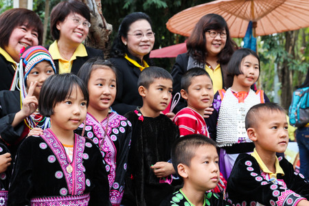 Chiangmai, Thailand - December 18, 2014: thailand hill tribe boy and girl with traditional northern tribe costume in royal project fair at Chiangmai university.