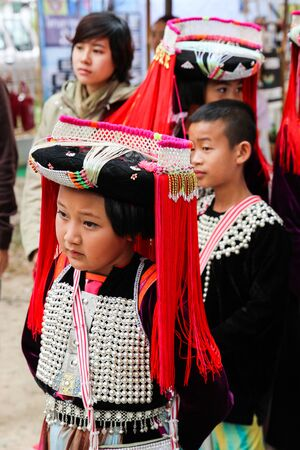 Chiangmai, Thailand - December 18, 2014: thailand hill tribe girl and boy with traditional northern tribe costume in royal project fair at Chiangmai university.