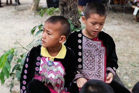 Chiangmai, Thailand - December 18, 2014: thailand hill tribe boy with traditional northern tribe costume in royal project fair at Chiangmai university.