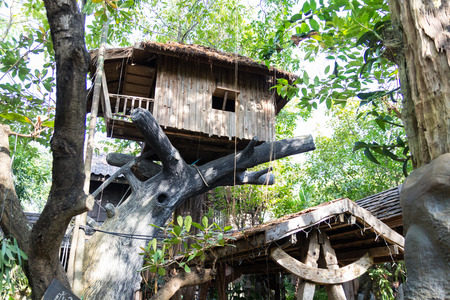 Uttaradit, Thailand - December 19, 2014: Wooden house on fake tree in the garden in Lomyen restaurant for  tourist taking picture.