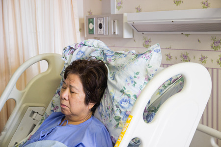 hospital patient: asian woman patient sleeping in hospital for recovery Stock Photo
