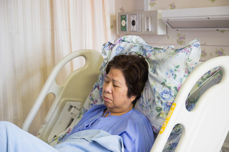 recuperation: asian woman patient sleeping in hospital for recovery Stock Photo