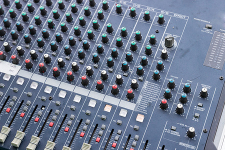 electronic music: slider and knob of sound mixer console