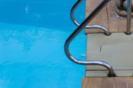 metal handrail: metal handrail at poolside of the swimming pool
