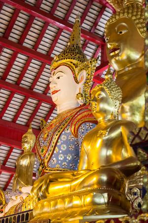 asian angel: asian angel and golden buddha statue in buddhist church