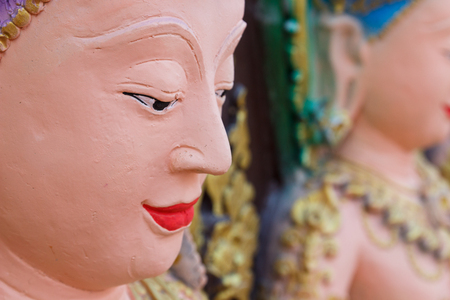 asian angel: asian angel statue beside the buddhist church
